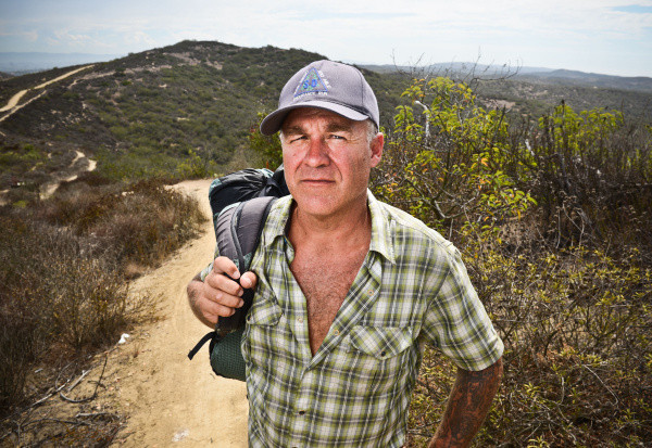 Avid hiker and runner, Joe Kisner, 47, practices regularly for his long distance hiking trips at El Moro Canyon. Kisner will receive the Triple Crowd Award for hiking the 2,200-mile Appalacian Trail, the 2,700-mile Pacific Crest Trail, and the 3,000-mile Continental Divide Trail.      ///ADDITIONAL INFORMATION: 0906 Ð hb.hiker_triplecrown.0819 Ð MACKENZIE REISS, ORANGE COUNTY REGISTER Ð    Avid long-distance hiker and runner, Joe Kisner, 47, will receive the Triple Crown Award for hiking three major trails - each more than 2,000 miles in length.